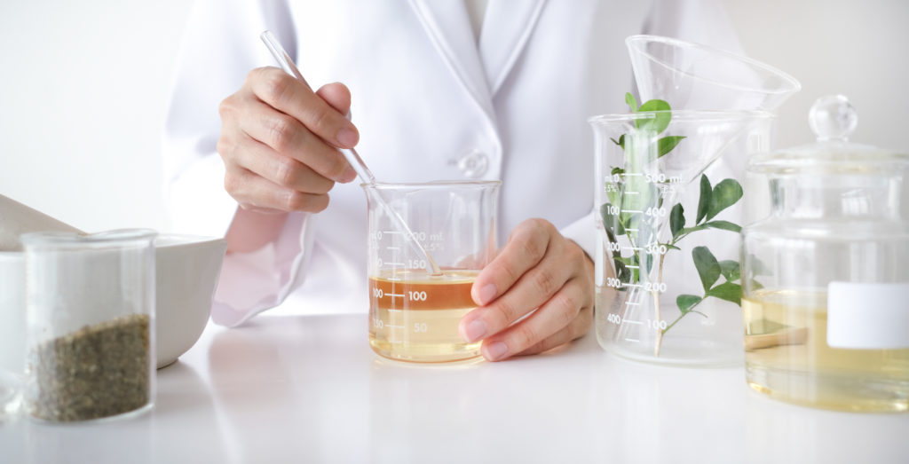Research & development measuring and mixing all natural ingredients for skincare products.